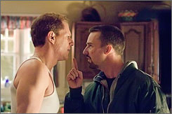 Warner Bros. Pictures Bad cop, good cop: Noah Emmerich, left, plays an officer whose principles have lapsed, and Edward Norton lets him know about it.