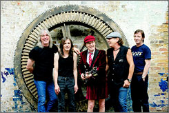 Loud and proud: Cliff Williams, left, Malcolm Young, Angus Young, Brian Johnson and Phil Rudd of rock legends AC/DC kicked off their North American tour Tuesday night.