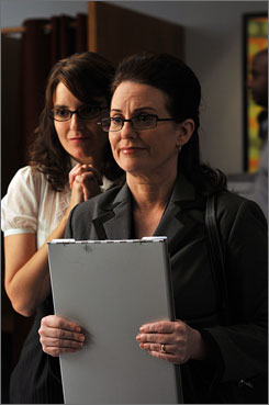 Liz Lemon (Tina Fey, left) tries to impress an adoption agency representative (guest star Megan Mullally) in the season premiere of 30 Rock.