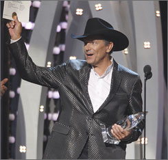 George Strait is famous for songs such as Amarillo By Morning,Ocean Front Property,Check Yes or No  and I Saw God Today.
