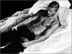 Victoria Beckham's husband, David, posed in an Armani fashion campaign.