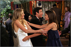 "After Stella (Sarah Chalke, left) and Ted (Josh Radnor, background) make the spontaneous decision to get married in three days, the presence of their exes destroys what was to be the ""happiest day of their lives."" Cobie Smulders (right) stars as Ted's ex, Robin."