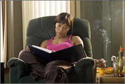 Burning issue: Angela Bassett smokes a cigarette in Akeelah and the Bee. Health groups are concerned about cigarette and cigar smoking in movies, even those rated G.
