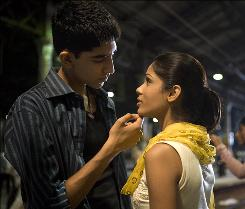 Dev Patel stars as Jamal Malik, an Indian orphan who loves, then loses, then tries to find his childhood sweetheart Latika (Freida Pinto) in Slumdog Millionaire. 