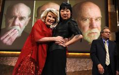 Comedians Joan Rivers, left, and Margaret Cho were among the funny folks paying tribute to the late George Carlin on Monday night at the Kennedy Center in Washington, D.C. At right is fellow comedian Lewis Black.