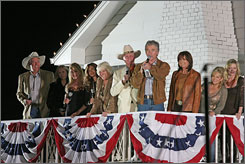 The cast of Dallas holds court at the Southfork Ranch during the show's 30th anniversary celebration Saturday.
