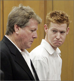 Ryan O'Neal and his son Redmond O'Neal appear for an arraignment on methamphetamine possession charges, at the courthouse in Malibu, Calif. on Thursday.  