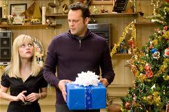 Reese Witherspoon and Vince Vaughn play a marriage-phobic couple who are forced to spend the holidays with an assortment of family and step-family in Four Christmases.