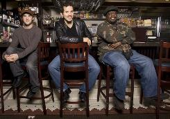 American Buffalo's solders: Haley Joel Osment, left, John Leguizamo, and Cedric the Entertainer star in the Broadway revival of David Mamet's American Buffalo. The play opens Monday in New York.