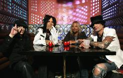 Motley Crue's Mick Mars, left, Nikki Sixx, Vince Neil and Tommy Lee will kick off their Saints of Los Angeles 2009 Tour on Feb. 2 in San Diego.
