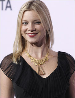 Amy Smart walks the green carpet at the Environmental Media Awards.