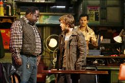 Cedric the Entertainer, left, Haley Joel Osment and John Leguizamo conspire to steal a rare Buffalo nickel in American Buffalo, the revival of a 1976 play by David Mamet. 