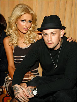 No more double dates with Joel and Nicole: Paris Hilton and Good Charlotte's Benji Madden have called it quits. His twin brother dates her good friend.