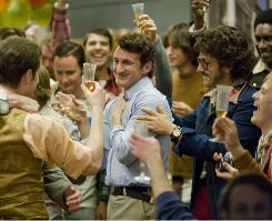 Sean Penn, center, plays the doomed gay politician Harvey Milk in Milk, out in some cities Wednesday.