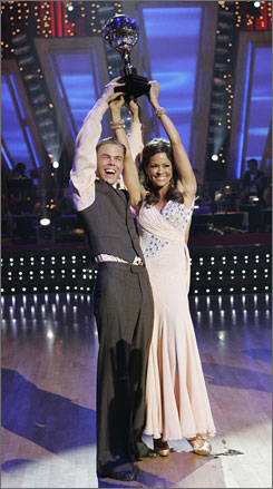 Brooke Burke and Derek Hough hoist their Dancing With the Stars trophy. Now  both Hough siblings have won the overall title.