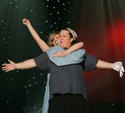 Not the same old song and dance: Rosie O'Donnell and guest star Jane Krakowski rehearse for Rosie Live.