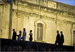 Guests arrive at San Cristobal Fort, in Old San Juan, Puerto Rico, to attend the wedding of Roselyn Sanchez and Eric Winter on Saturday.