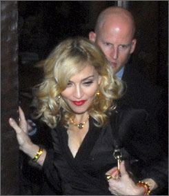 Madonna departs a Buenos Aires restaurant after dinner Tuesday.