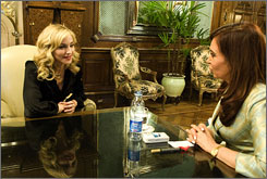 Madonna, left, chats with Aregentine president Cristina Fernandez at the presidential palace where the singer filmed scenes for her 1996 movie Evita. 