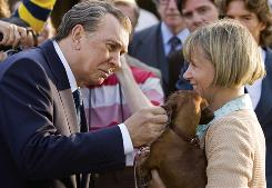 It's an awkward moment for Richard Nixon (Frank Langella) when he stops to pet a dog after his last interview with David Frost.