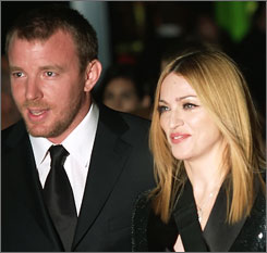 Guy Richie and Madonna say the  $76-92 million settlement figure her publicist releaesd Monday is inaccurate. And they say the real sum is none of our business.