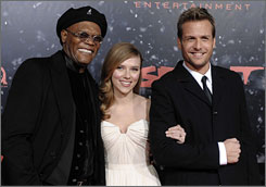 Samuel L. Jackson and Gabriel Macht squire Scarlett Johansson down the Spirit red carpet.