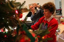 Familiar tradition: Bob and Carol Blackwell decorate their Christmas tree at their home in Great Falls, Va. Bob, 66, has Alzheimer's.
