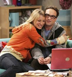 Hugs all around: Kaley Cuoco and Johnny Galecki have reason to celebrate, as The Big Bang Theory hits a series high with 11.2 million viewers and contributes to CBS' big week.