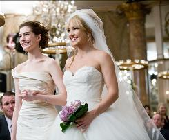 Best friends Anne Hathaway, left, and Kate Hudson learn their weddings are scheduled on the same day in Bride Wars, a romantic comedy due Jan. 9.