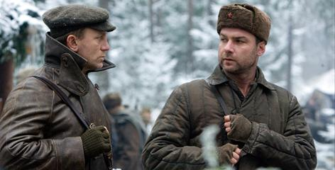 Daniel Craig, left, and Liev Schreiber are two of three brothers who join the Russian resistance in 1941 and create a mini-civilization in the Belorussian forest.