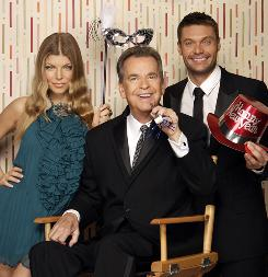 A little help from his friends: Ryan Seacrest, right, will be the main host of the show with Dick Clark in Times Square, and Fergie will be on hand in Hollywood.