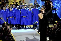 Faith Hill performs during her CBS special,  A Home for the Holidays, which aired Dec. 23. The annual show celebrates the joys of adopting children in foster care.