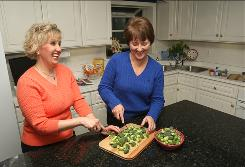 Dietitians Tami Ross, left, and Patti Geil recommend cutting broccoli florets at home instead of purchasing pre-cut florets, which is more expensive.