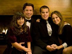 Actor John Travolta and his wife, actress Kelly Preston, with daughter Ella Bleu and son Jett, who died Friday at 16. Jett, who had a history of seizures, was found unconscious in a bathroom at his family's home at the Old Bahama Bay resort on Grand Bahama Island.