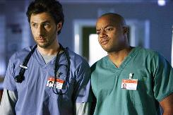 J.D. (Zach Braff), left, will bid farewell to his best friend, Turk (Donald Faison), when the eighth season of hospital comedy Scrubs comes to a close.