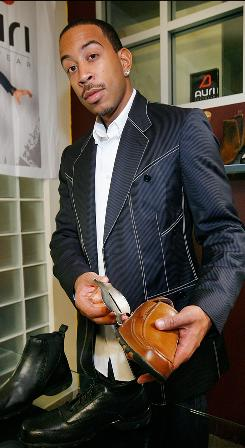In his shoes: Auri Footwear designed by Ludacris will be going up for bid to benefit the organization Stars for a Cause.
