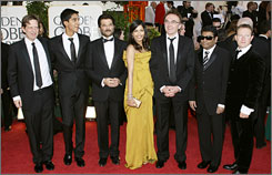 Slumdog Millionaire: Producer Christian Colson, actors Dev Patel and Anil Kapoor, actress Freida Pinto, director Danny Boyle, composer A.R. Rahman and writer Simon Beaufoy on the red carpet. The film later won four awards, including the big prize for best drama.