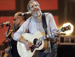 British pop legend Yusuf, formerly known as Cat Stevens, performs during the Live Earth concert in Hamburg in 2007. Now he's releasing reissues of early albums Tea for the Tillerman and Teaser and the Firecat.