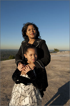 "Parallel roads: Felicia Wade, with her daughter, Amanda, 8, on top of Stone Mountain in Georgia, sees parallels between her life and touchstones in the lives of Martin Luther King Jr., as well as the Obamas. She calls the inauguration a ""full-circle moment"" for her."