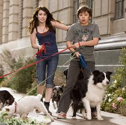 All tied up: Orphans Emma Roberts and Jake T. Austin are on a mission to save some stray pooches.