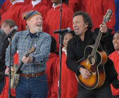 All-American: Pete Seeger and Bruce Springsteen capture the moment with This Land is Your Land.