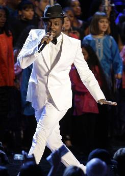 Singer will.i.am performs at the Neighborhood Inaugural Ball, the first stop of the night for the new president and his wife.