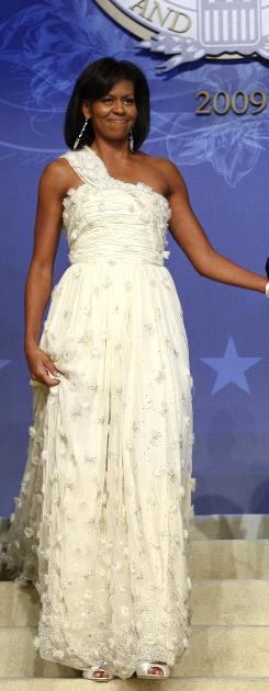 First lady Michelle Obama makes her entrance at the Home States Ball, which honored Hawaii and Illinois, in her Jason Wu gown.