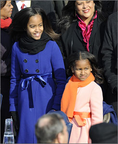 Malia, left, and Sasha Obama were decked out in J. Crew for their father's inauguration Tuesday.