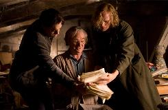 In a world where books can become reality, Fenoglio (Jim Broadbent, center) finds his original manuscript for Inkheart as Mo (Brendan Fraser, left) and Dustfinger (Paul Bettany) grab at the pages.