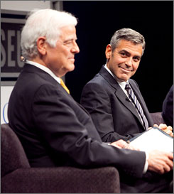 George Clooney, right, looks on at his father Nick Clooney during a discussion at the Newseum.