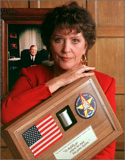 "Majel Barrett Roddenberry, seen here holding the ashes  of her husband, Star Trek creator Gene, died on Dec. 18.  Her remains and the rest of his will be launched into space next year. James ""Scottie"" Doohan received the same treatment in 2007."