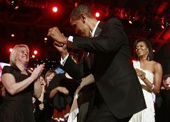 President Obama dances in front of his wife, Michelle, and guests at the Neighborhood Ball, whose live coverage on ABC drew 12.6 million viewers.