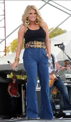Headlines about Jessica Simpson's weight gain has the singer on the defensive.