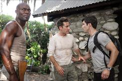 Sen. Nathan Petrelli (Adrian Pasdar), center is on a mission to hunt down those with extraordinary powers, including his brother, Peter (Milo Ventimiglia). The Haitian (Jimmy Jean-Louis) stands guard.